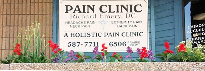 Chiropractic Kansas City MO Emery Chiropractic Clinic sign with flowers